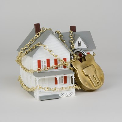 Model of house with padlock