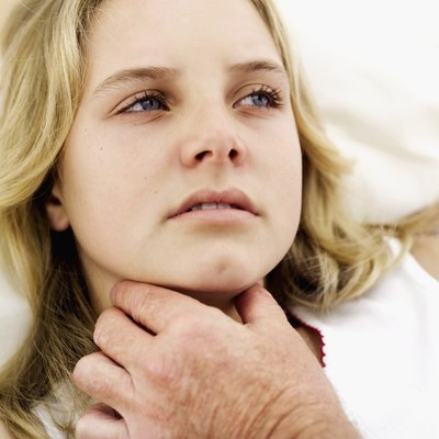 Because the lymph nodes in the neck are swollen, you may experience trouble breathing, coughing, or even chest pains.