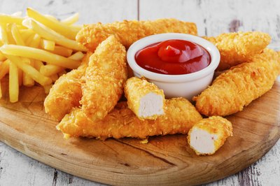Chicken tenders with french fries and ketchup