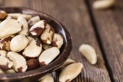 A bowl filled with Brazil nuts.