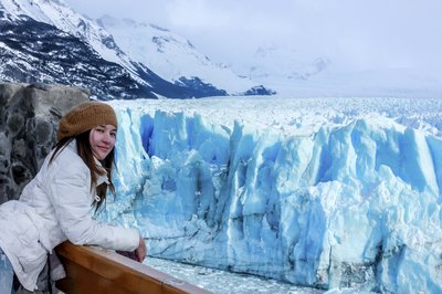 Woman aboard cruise ship near Antarctic glacier