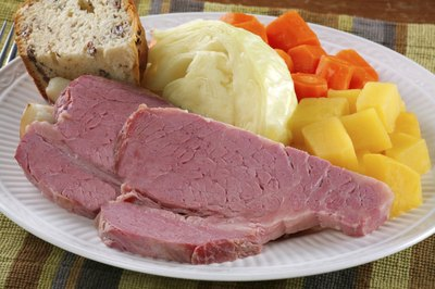 Slices of corned beef and vegetables.