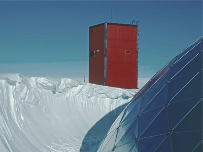 Thirty foot tall snow drift against the old dome structure of the Amundsen Scott Station