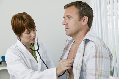 doctor checking patient's heart rate