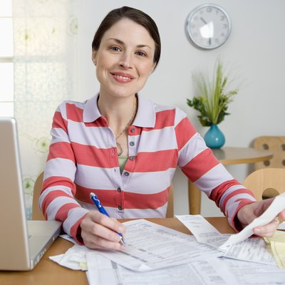 Woman paying taxes