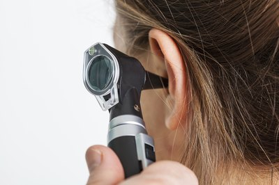 An otoscope is used by a doctor to examine the ear.