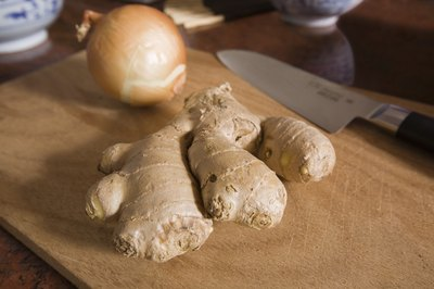 A Ginger root on a cutting board.