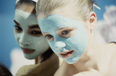 Two girls wearing facial masks.
