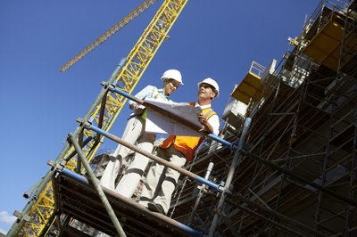 Construction supervisors on a scaffold platform