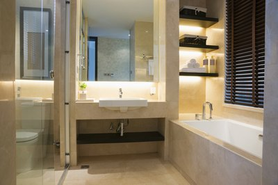 Lighting behind the vanity and shelves in a contemporary bathroom.