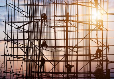 Specially trained workers on scaffolding