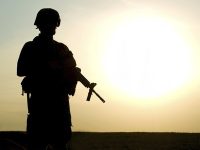 Private military contractors work alongside or in place of military personnel.