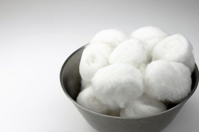 Soak a cotton ball in alcohol.