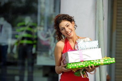 woman laughing with gifts