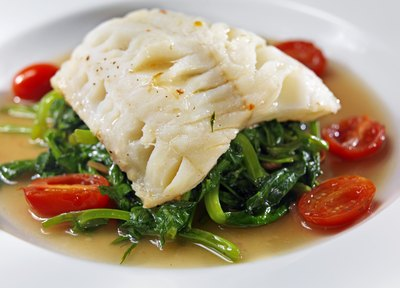 Halibut filet served over vegetables