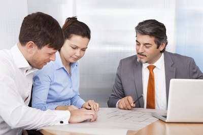 A married couple consults with a financial advisor.