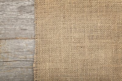Burlap material on a wood surface.