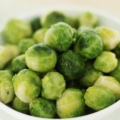 Fresh Brussels sprouts in a bowl.