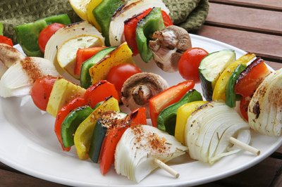 Assorted vegetable kabobs on plate