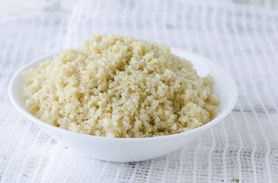 A bowl of cooked quinoa.