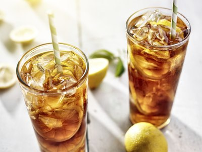 Two tall glasses of iced tea.