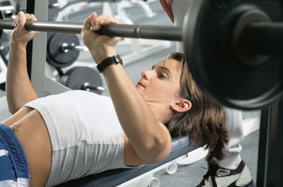 Bench press focuses on working the chest but uses other muscles as well.
