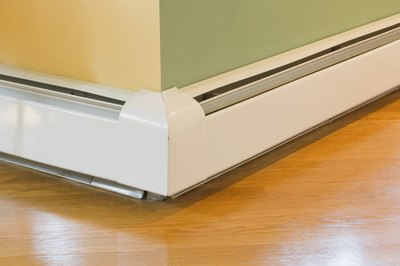 Baseboard heaters can provide draft-free warmth in basement family rooms.