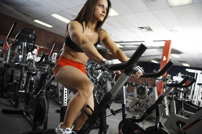 Riding a stationary bike burns calories and builds muscle.