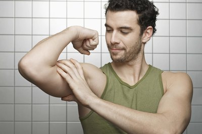 Build your biceps at home with towel exercises.
