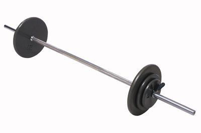 Proper form during a barbell shoulder press prevents injury.