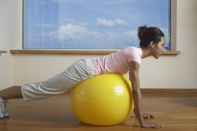 Lying leg lifts are just one exercise to tone your legs and glutes with a yoga ball.