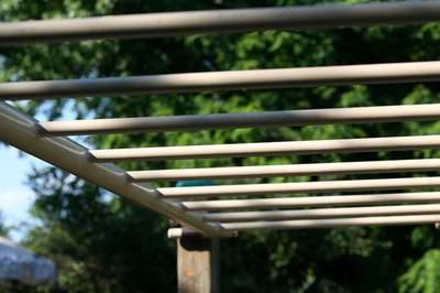 Use the outside of the monkey bars for one type of lateral pull-up.