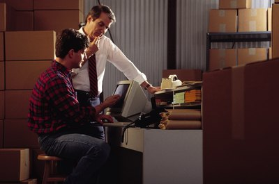 Replenishment associates often help process inventory records via computers.