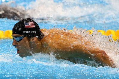 Michael Phelps swims the butterfly stroke in the 2012 Olympic medley relay.