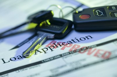 Both the applicant and co-applicant's credit reports affect the car loan's terms.