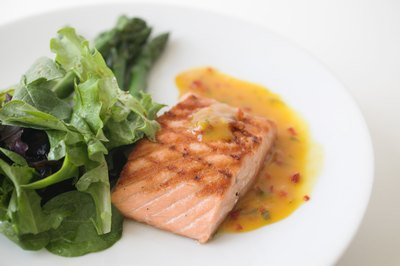 Salmon and leafy greens contain nutrients highlighted in a Mediterranean style diet