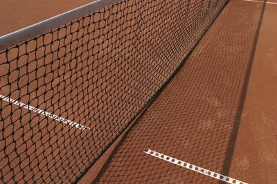The rules of tennis dictate when to switch sides of the court.