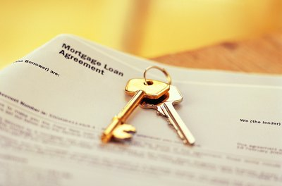 Pledging your house as collateral usually involves signing a mortgage.