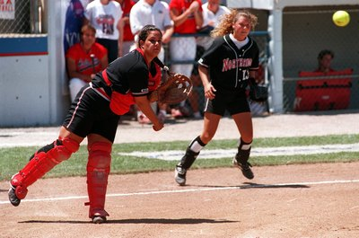 Cal State Northridge catcher Scia Maumausoio throws the ball in a game against Arizona.