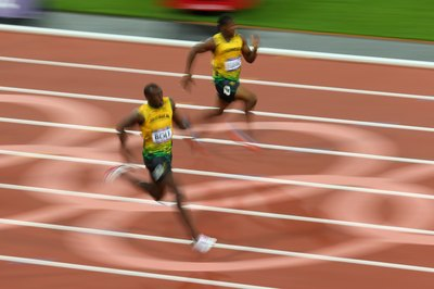 Usain Bolt runs the 200-meter dash at the 2012 Olympics.