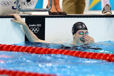 Olympian Missy Franklin wears a swim cap while competing.
