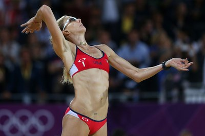Kerri Walsh Jennings of the United States relies on arm strength to make a hit.