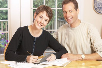 Create a budget together so both of you understand the household finances.