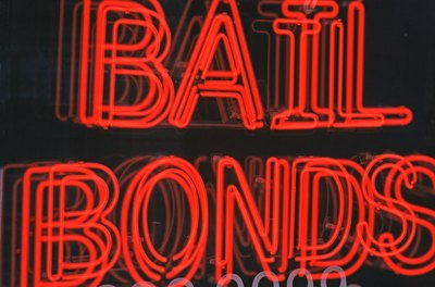 Bail bondsmen guarantee a defendant's appearance in court.