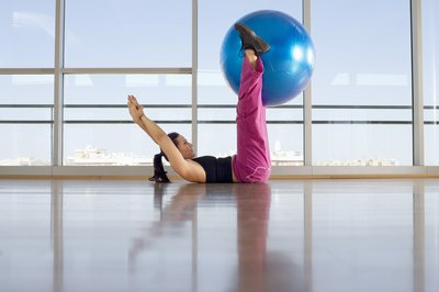 You can perform leg extensions with a stability ball.