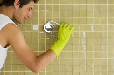 Baking soda and vinegar are inexpensive and non-toxic shower cleaners.