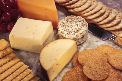 Choose whole-grain crackers and low-fat cheeses for a healthy snack.