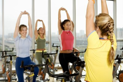 Arm stretches mean spin class is almost over, and you survived.