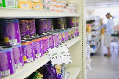 Canned dog food can often be found in its own section at the pet store.