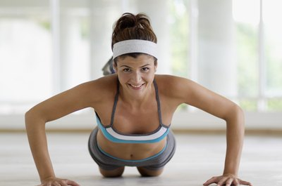 Push-ups are just one chest exercise that can boost the muscles under your bust.
